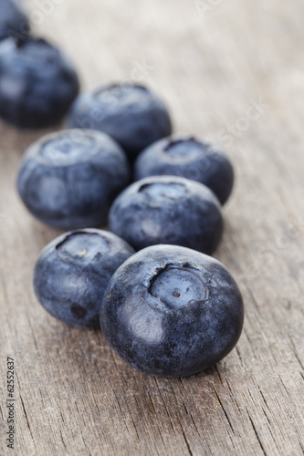 ripe blueberries on wooden table