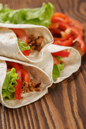 burrito with meat and ingredients