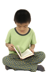 Cute child is reading a book