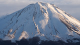 The summit of Mount Fuji covered with snow, a world heritage