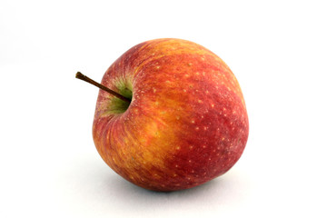 Ripe juicy apple on a white background