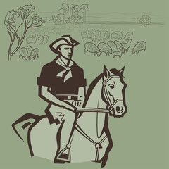 Cowboy herding sheep