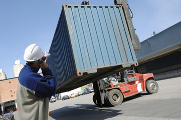 giant truck loading shipping and cargo containers