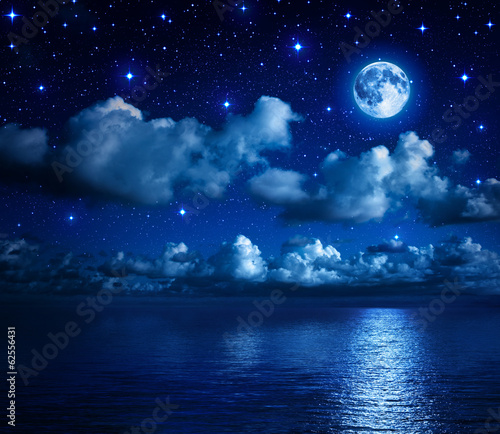 Fototapeta super moon in starry sky with clouds and sea
