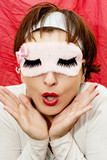 Attractive woman in sleep mask with a surprised look