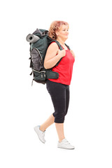 Mature woman walking with backpack