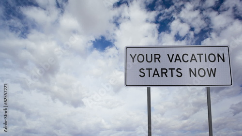 Sign Vacation Now Clouds Timelapse