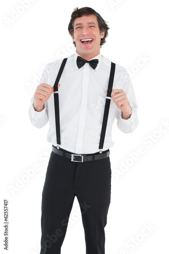 Cheerful groom wearing suspenders