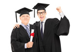 Mature and younger college student celebrating graduation