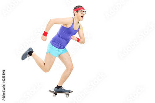 Nerdy guy riding a small skateboard