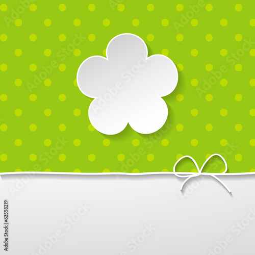 green background with a flower and a border