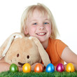 Cute child is happy to found her Easter eggs