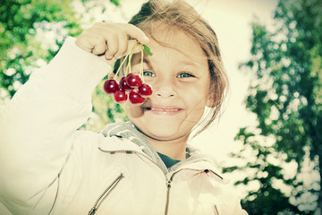 child and cherries