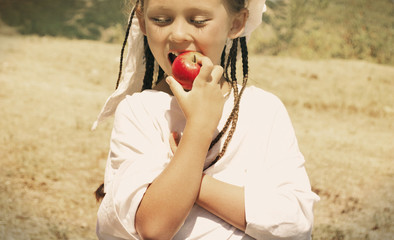child eats an apple