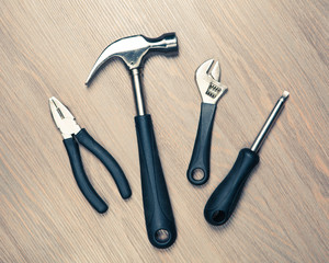 tools against wooden background