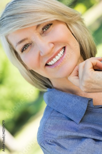 Smiling woman in park