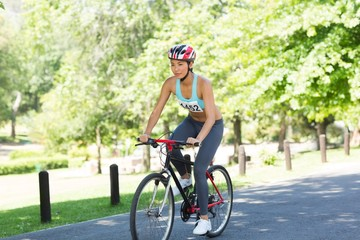 Female cyclist riding bicycle