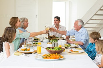 Family toasting while having meal