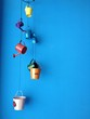 hanging small bucket on blue wall