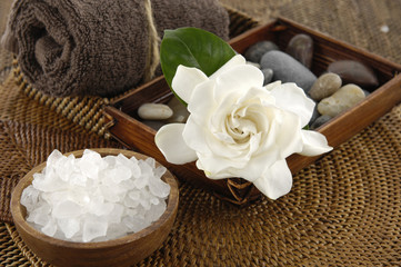 spa salt in bowl and gardenia flower and stones