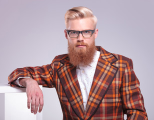 fashion man with long red beard and glasses resting