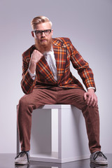 seated fashion man with beard and glasses