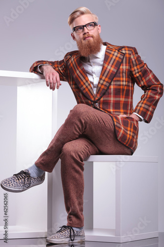 fashion man in vintage clothes and long beard looking away