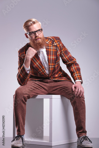 male model with long beard looking away from the camera