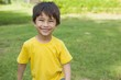 Portrait of a cheerful boy at park