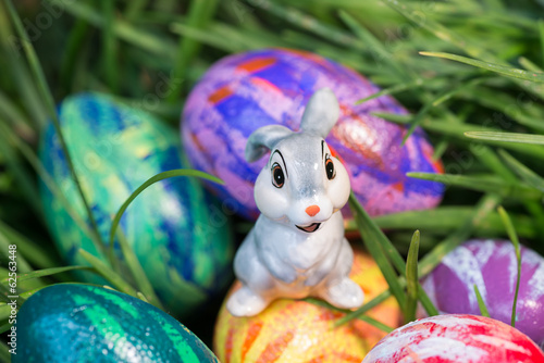 Bunny sitting on top of an Easter egg close-up