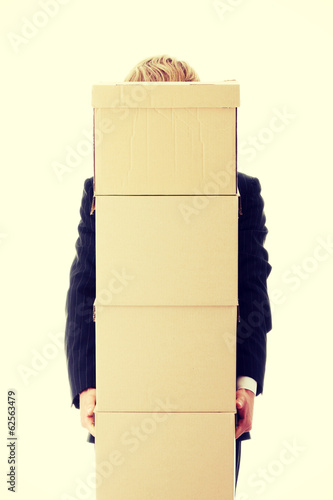 Businessman with stacked Boxes