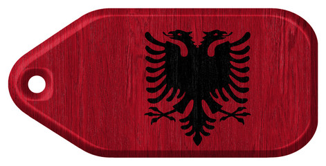Albanian flag painted on wooden tag