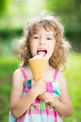 Happy child eating ice cream
