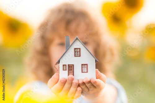 House in children's hands