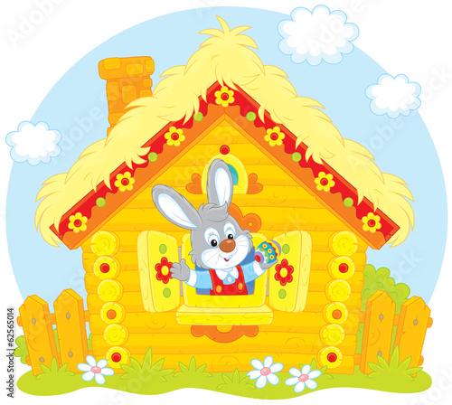 Fotobehang Boerderij Easter Bunny in his small log hut
