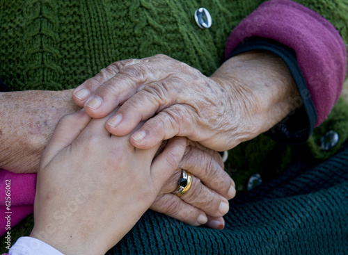 Child and grandmothers hand.