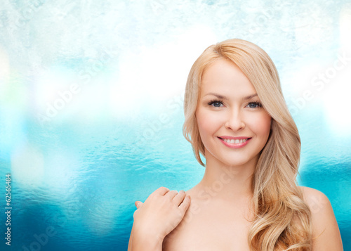face and shoulders of happy woman with long hair