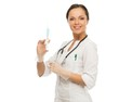 Young positive doctor woman with syringe