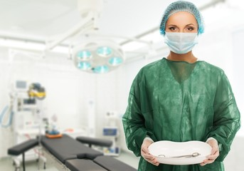 Young woman doctor holding medicine tray