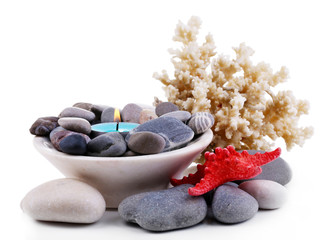 Composition with spa stones, candle, coral and star fish,