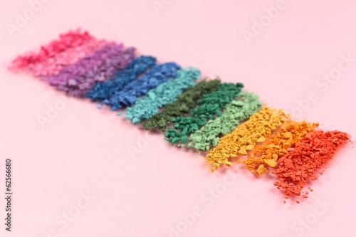 Rainbow crushed eyeshadow on pink background