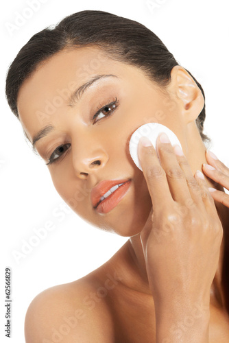 Beautiful woman with cosmetic pad.