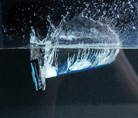 Men shaver in water close-up