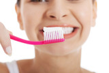 Woman holding tooth brush - 62567852