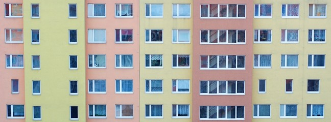Windows of the rooms in the big apartment building.