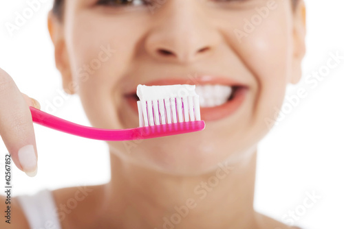 Woman holding tooth brush