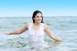 Summer happy woman in water