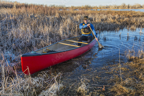 canoe paddling through a swamp