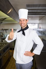 Portrait of a smiling male cook gesturing thumbs