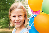 smiling girl with balloons